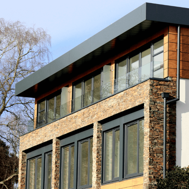 Modern square building with charcoal windows and doors