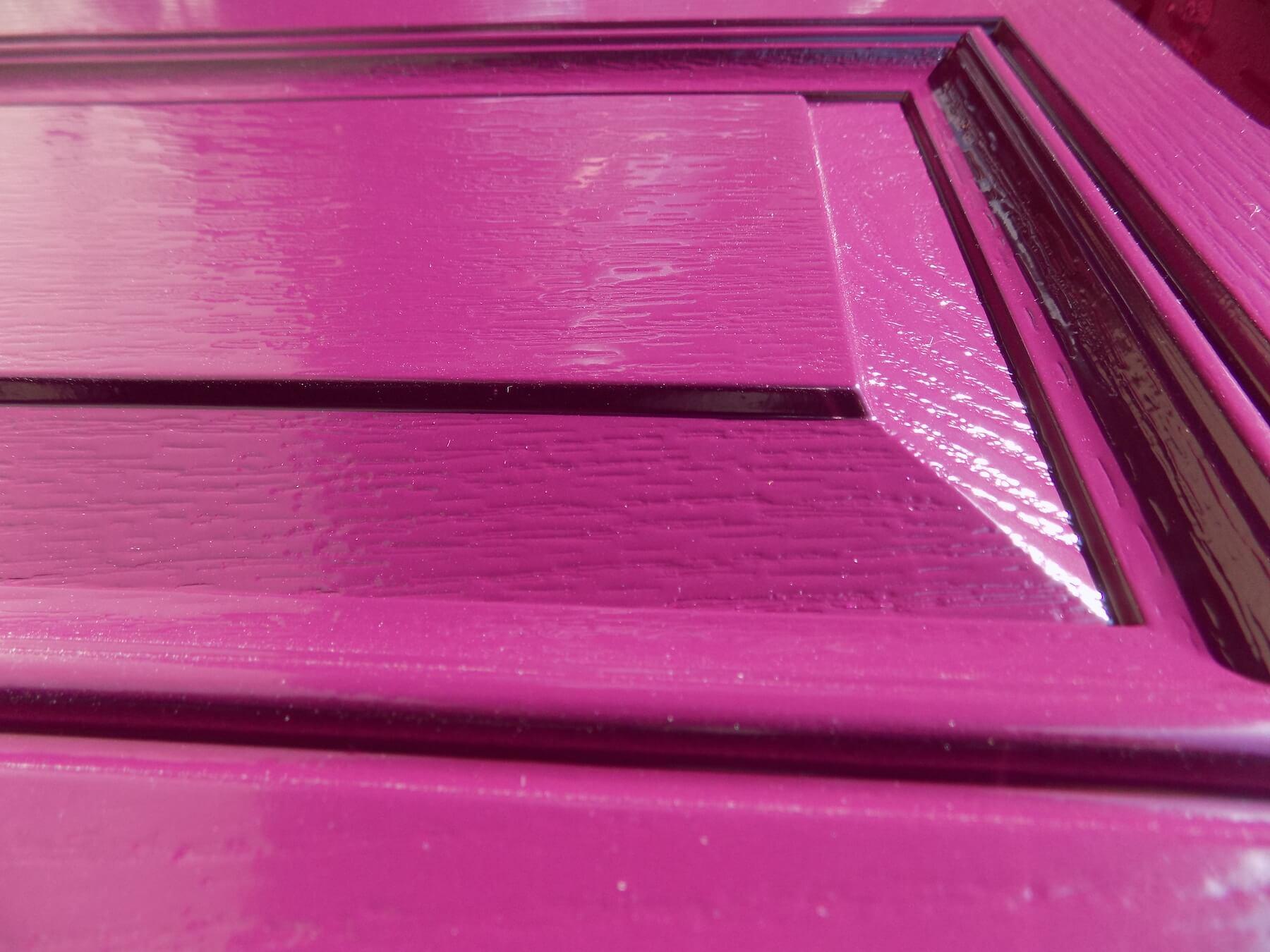 Hot pink coloured coated door