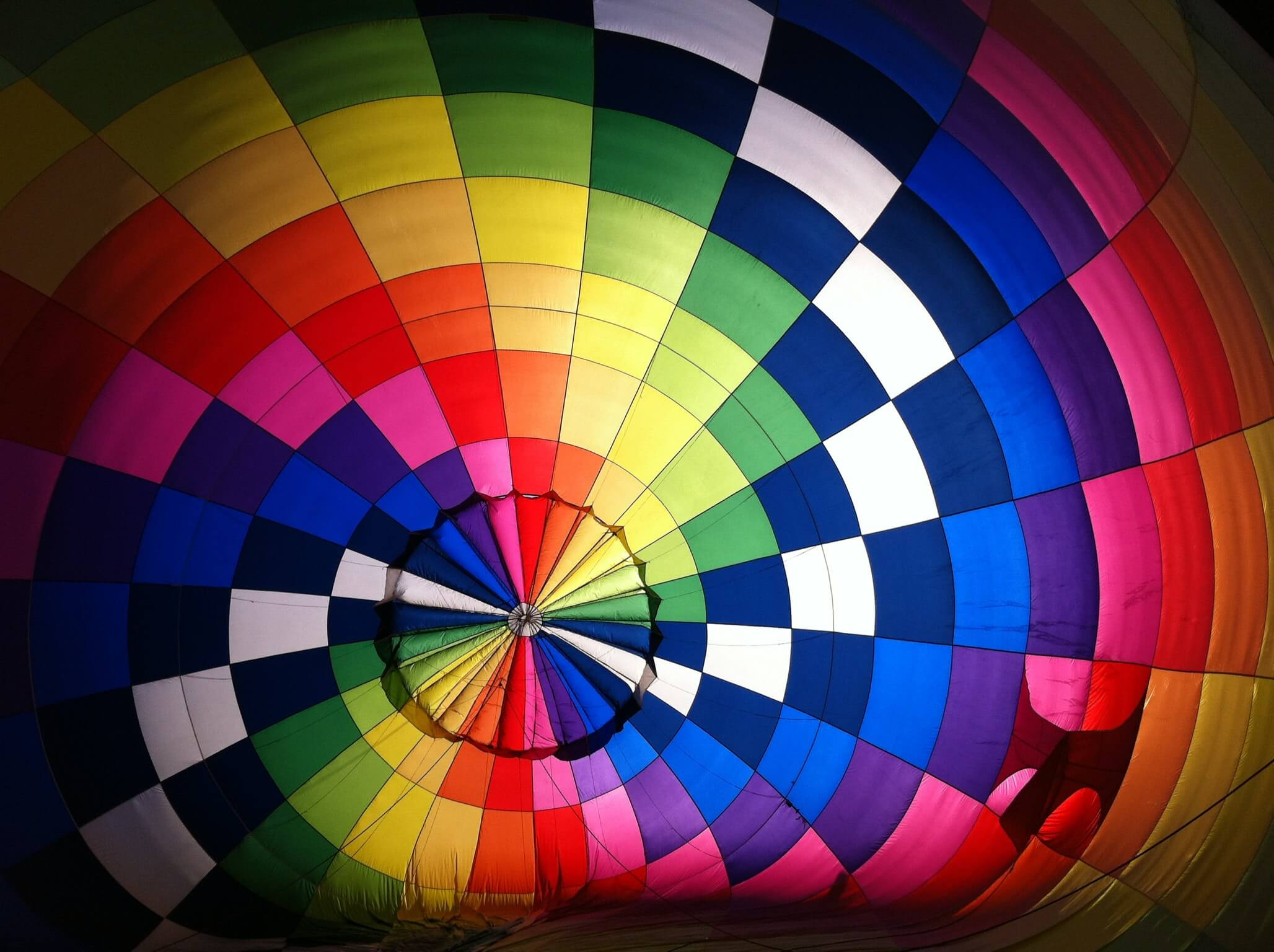 Large parachute in rainbow colours