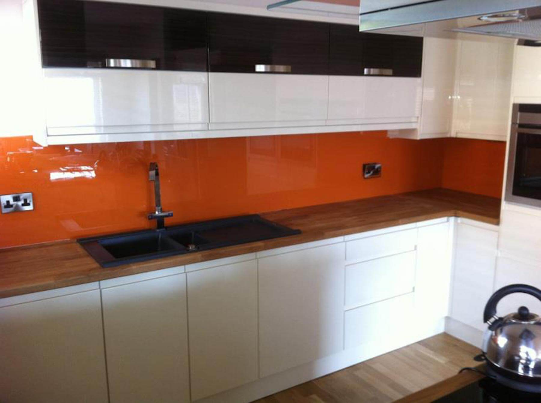 Orange splash backs in kitchen