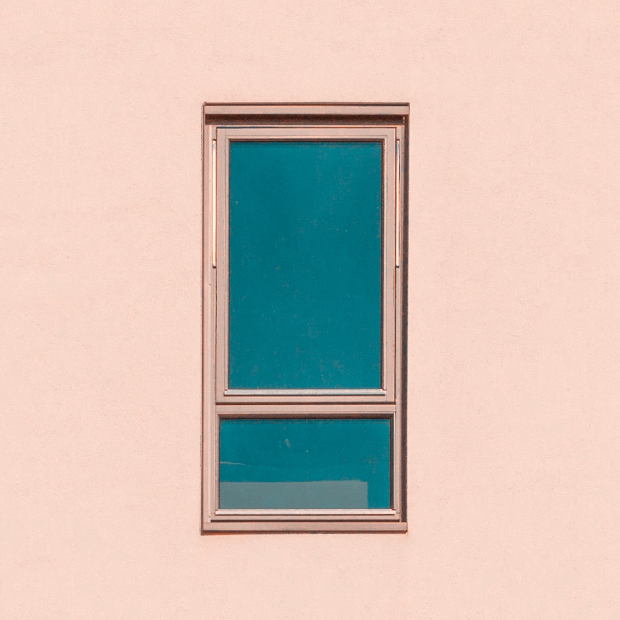 Window on a light pale pink wall