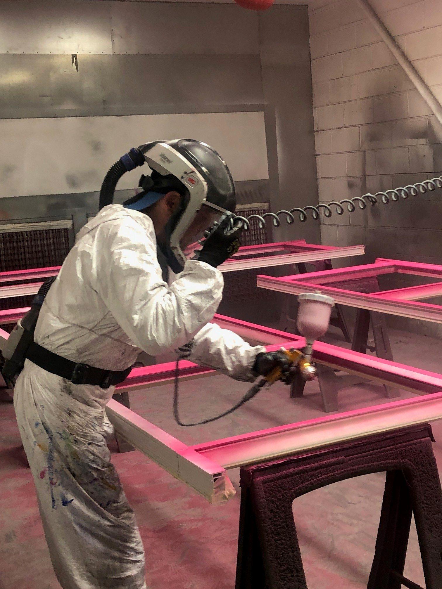 Man spraying a door pink