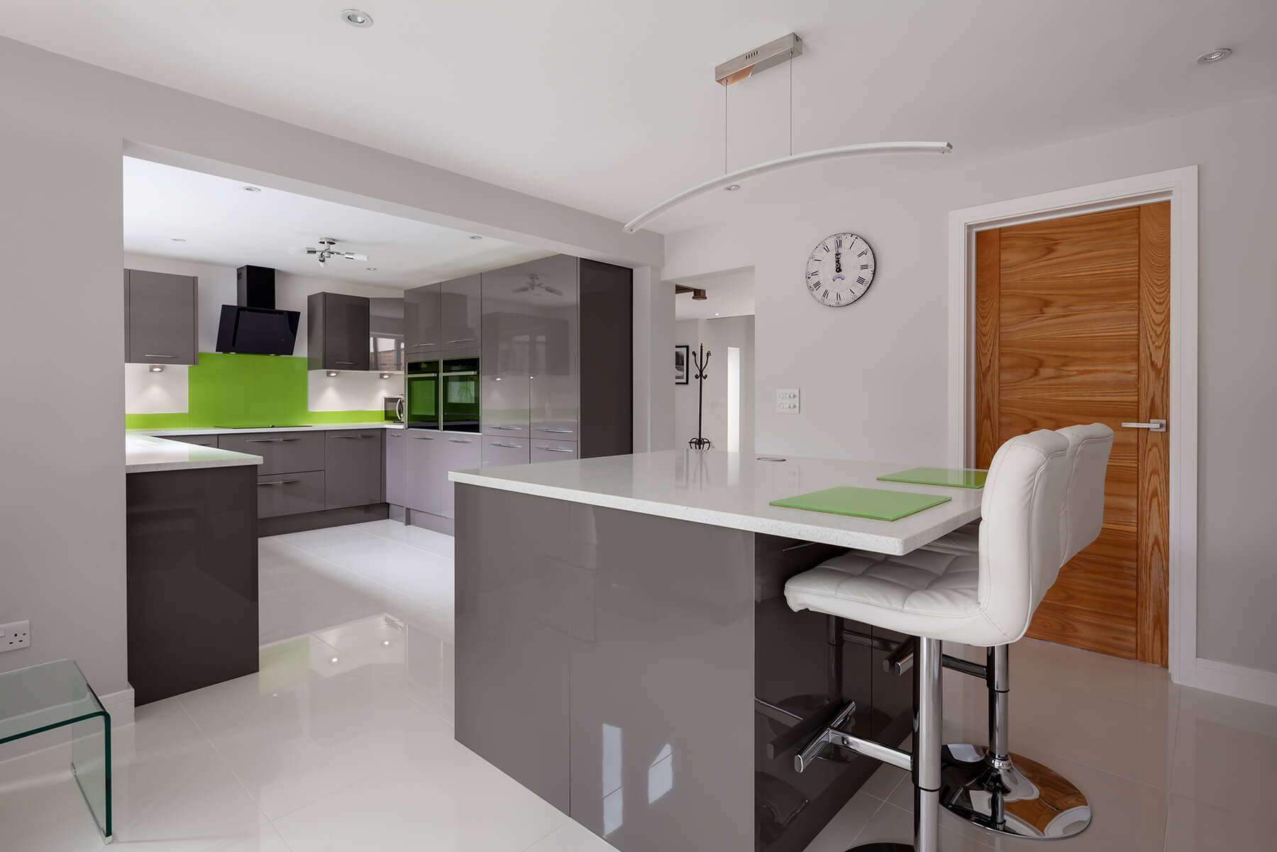 Modern kitchen with green splashback